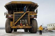 Canadian workmen operating large construction vehicle