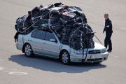 Car covered in heavy baggage