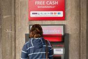 Student using ATM cash point machine