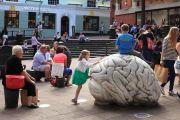 Children climbing on sculpture by-Anne and Patrick Poirier, Norwich, Norfolk