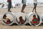 Children inside water pipes, Marina Beach, Chennai, India