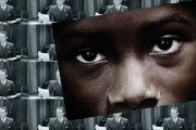 Child's eyes in front of collage of white businessmen