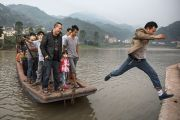 Man leaps from boat, China