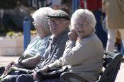 Elderly man and women sitting on bench