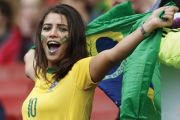 Female Brazilian football/soccer fan celebrating with flag of Brazil, Best universities in Latin America