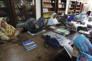 Female students reading in Peshawar University library