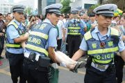 Gao kao exam in China. Policemen rescue woman who fainted