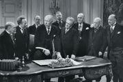 Group of old men signing paperwork