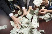 Hands grabbing dollar bills