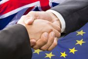 Handshake in front of European Union and United Kingdom flags