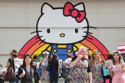 Hello Kitty mural with people in a group of people in front of it