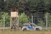 September 10, 2016: Hungarian policemen watching the Serbia Hungarian border fence