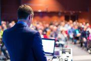 Speaker giving presentation at conference