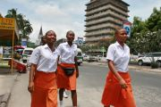 Girls walk along a street in Dar es Salaam, Tanzania