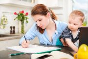 Student mother working with baby