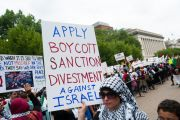 Demonstrators march on the White House in Washington, D.C., to protest Israel's offensive in Gaza, August 2, 2014