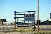 Sign supporting the Democratic Party on a shabby rack beside the road