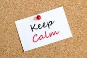 'Keep calm' note pinned to corkboard