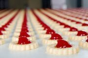 Long rows of jam-filled biscuits