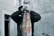 Man holding big fish with UK bank note projected