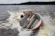 Man holding onto capsizing boat