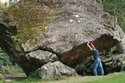 Man holding up rock