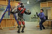 Man lifting robot for testing in preparation for the Defense Advanced Research Projects Agency (DARPA) robotic challenge