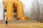 Man looking at statue of Mao Zedong, China, 2016