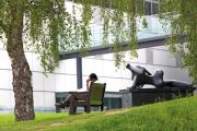 Man reading on bench, University of East Anglia