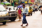 Man walking across congested street, Yangon, Myanmar