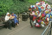 Man with lots of balloons