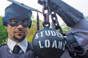 Masked man shackled by 'Student Loans' ball and chain