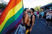 Men kissing with pride flag