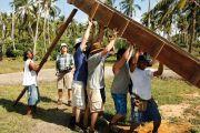 Men lifting wooden construction frame, Tasbapauni, Nicaragua