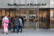 Group of women enters Museum of Modern Art in New York
