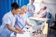 Nurses looking at chart