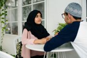 A Pakistani man and woman talking