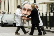 People carrying model of Albert Einstein's head, Science Museum, London, England