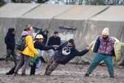 People help man stuck in mud at music festival, Notre-Dame-des-Landes, France