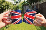 People holding Union Jack flag tea cups