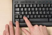 Person pressing Ctrl-Z on PC computer keyboard