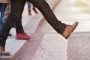 Person stepping onto pedestrian crossing