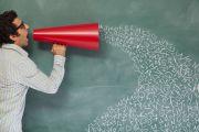 PhD viva/man speaking through megaphone