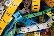 Pile of colorful measuring tapes