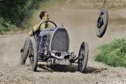 Racecar losing wheel as it turns corner