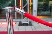 Red velvet ropes outside VIP event venue