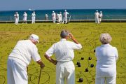 Retired academics calculating moves while playing bowls