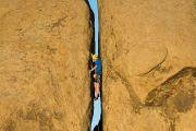 Rock climbing narrow crevice