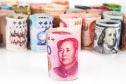 Rolled-up bank notes with Chinese currency at front