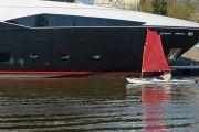 Tiny boat next to luxury yacht